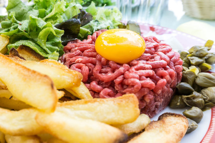 Bacon Breakfast Close-up Cultures Day Egg Yolk English Breakfast Fast Food Food Fried Fried Egg Ham Indoors  Meal Meat No People Processed Meat Raw Beef Raw Food Ready-to-eat Red Meat Sausage Tomato Unhealthy Eating
