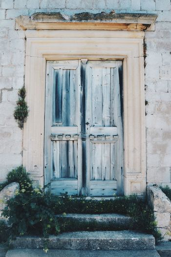 Close-up of closed door of house