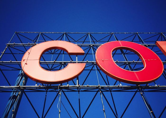 Doing some late afternoon shopping. Has a real 60's urban feeling to it. Shopping Grocery Shopping Typography Type Letter C Letter O Steel Structure  Blue Sky Urbanphotography Signage