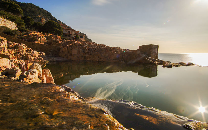 Es Cau natural pool, Begur Scenics - Nature Tranquility Outdoors No People Tranquil Scene Beauty In Nature Nature Solid Rock - Object Rock Formation Rock Water Natural Pool Sky Reflection Begur Costa Brava Es Cau Natural Pool Sunrise Smooth Water Silky Water