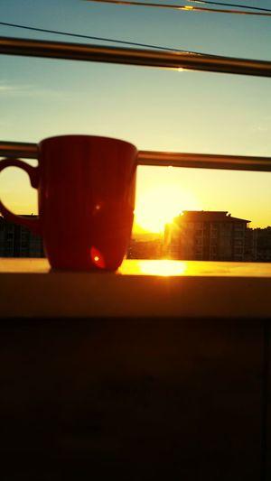 EyeEmNewHere City Sunset Drink Window Sunlight Sky Close-up Ice Tea Ice Cube Teabag Black Tea