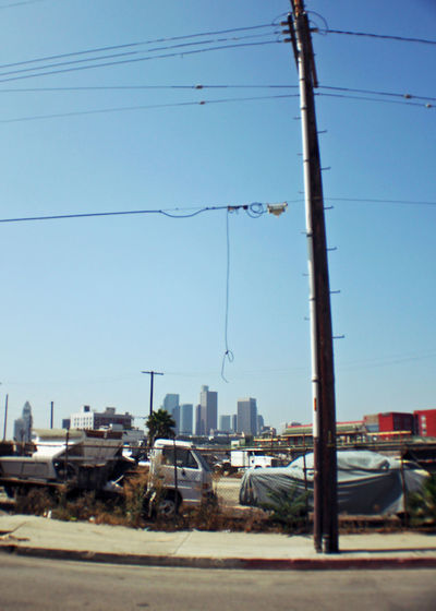 1990🔙 Los Angeles - Street Architecture Building Exterior Built Structure Cable City Clear Sky Connection Day Downtown Los Angeles Electricity  Electricity Pylon Feels Like Summer Fuel And Power Generation Lalaland No People Outdoors Power Line  Power Supply Sky Technology Telephone Line Transportation