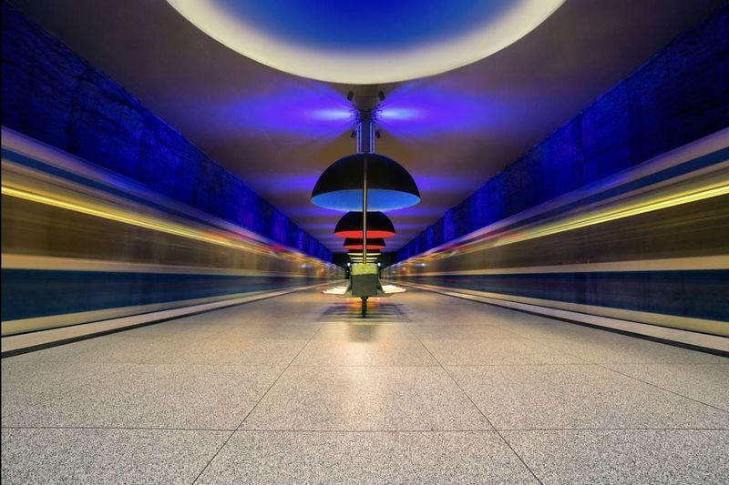 Illuminated light trails on subway station