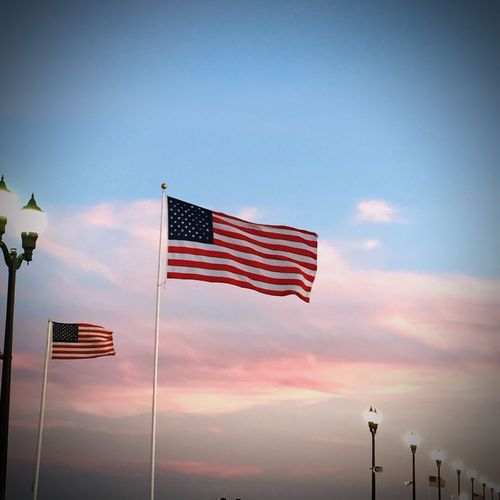 American flags waving at sunset