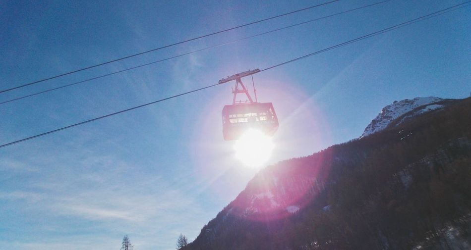Lens Flare Sunbeam Low Angle View Sky Cold Temperature Nature Sun Winter Snow Outdoors Transportation No People Day Mountain
