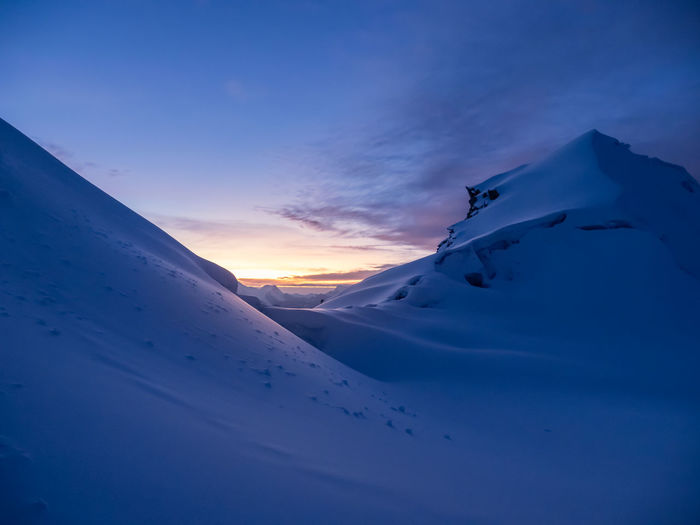 Sky Beauty In Nature Scenics - Nature Winter Snow Cold Temperature Mountain Cloud - Sky Tranquility Tranquil Scene Sunset Nature Non-urban Scene No People Blue Environment Snowcapped Mountain Idyllic Remote Mountain Peak