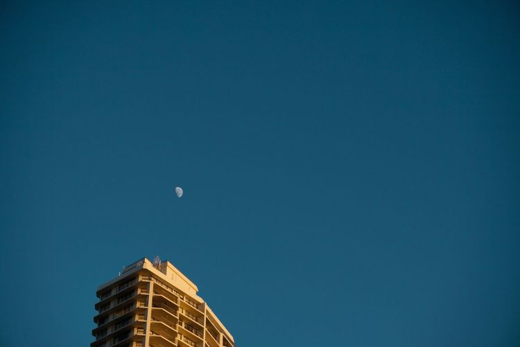 Moon in sight Copy Space Architecture Blue Built Structure Building Exterior Low Angle View Moon Clear Sky Crescent No People Nature Night Outdoors Beauty In Nature Astronomy Sky Half Moon Minimalism Minimal Minimalist Architecture Streetphotography GoldCoast
