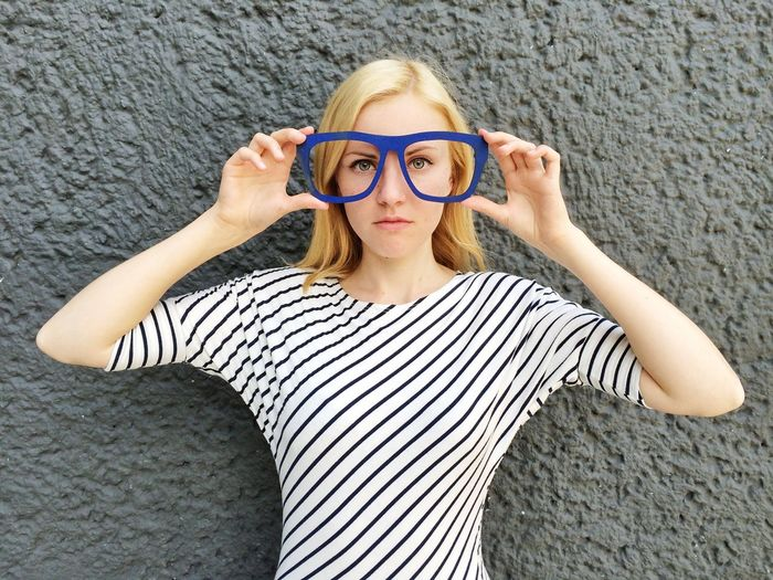 Portrait of young woman with oversized eyeglasses