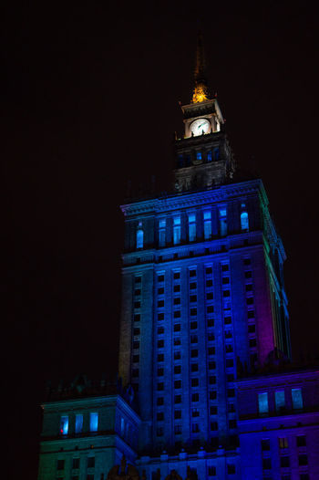 Poland Warsaw Europe Building Exterior Night Architecture Built Structure Illuminated Building Tower Travel Destinations Low Angle View Clock Tower No People City Sky Tall - High Government History The Past Travel Clock Full Moon Skyscraper Office Building Exterior Spire