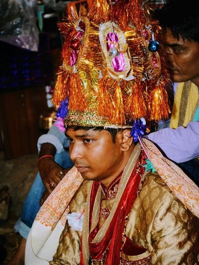 Thoughtful Bridegroom Wearing Headdress During Wedding Ceremony