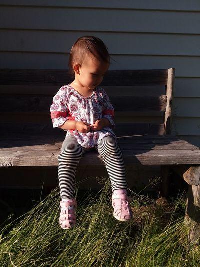Cute girl sitting on bench
