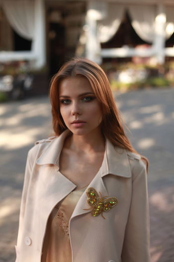 Adult Beautiful Woman Beauty Brown Hair Contemplation Focus On Foreground Front View Hair Hairstyle Leisure Activity Lifestyles Looking At Camera One Person Portrait Real People Standing Women Young Adult Young Women