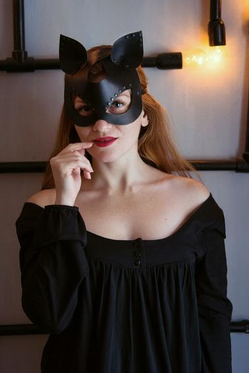 Portrait of young woman in eye mask