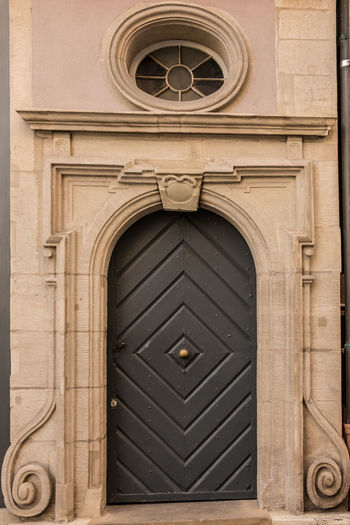 Old door of a historical building with stairway Architecture Built Structure Entrance Door Building Exterior Arch Closed No People Building Day Security Place Of Worship Safety Protection Belief Religion The Past Outdoors Design Craft Ornate