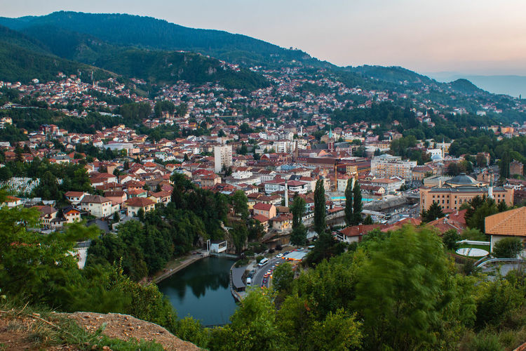 Sarajevo cityscape from the hill with view on the miljacka river and the library.
