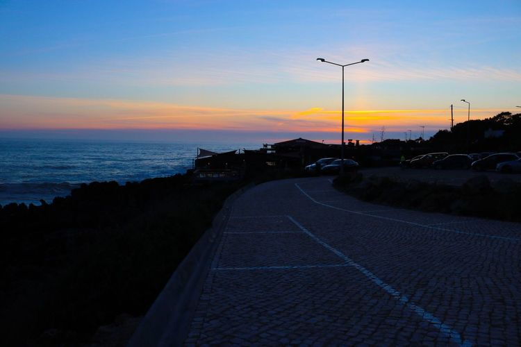 Sunset Road The Way Forward Sky Nature No People Transportation Outdoors Scenics Tranquility Sea Beauty In Nature Day in Guincho Connected By Travel