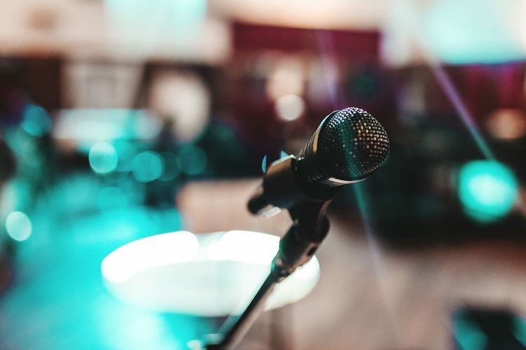 Close-up of microphone at popular music concert