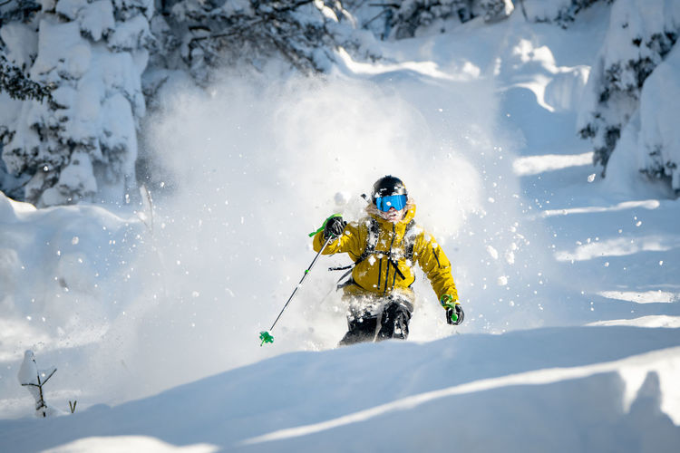 Adult man skiing in deep powder snow in the backcountry, werfenweng, austria.