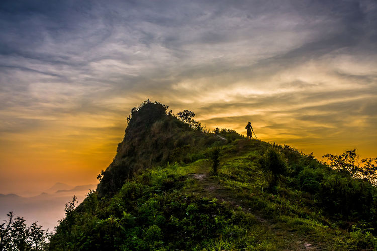 Cliff under dramatic sky at sunset in thailand