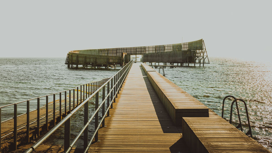 Kastrup Søbad Architecture Beauty In Nature Blackandwhite Built Structure Clear Sky Copenhagen Copenhagen, Denmark Denmark Dog Dogwalk Horizon Over Water Kastrup Man Nature Outdoors Pier Scenics Sea Sky Tranquil Scene Tranquility Walk Water Wood - Material Wood Paneling
