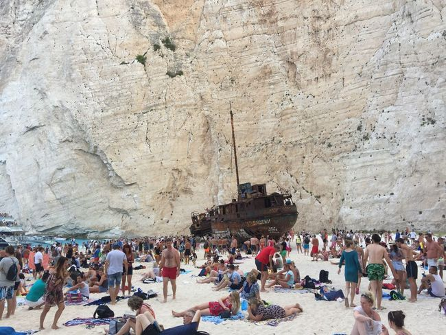 A beauty of ugly thing. 🙈 (2) Greece Photos Zakynthos Island Large Group Of People Tourism Travel Destinations Rock - Object Cliff Nautical Vessel Beach