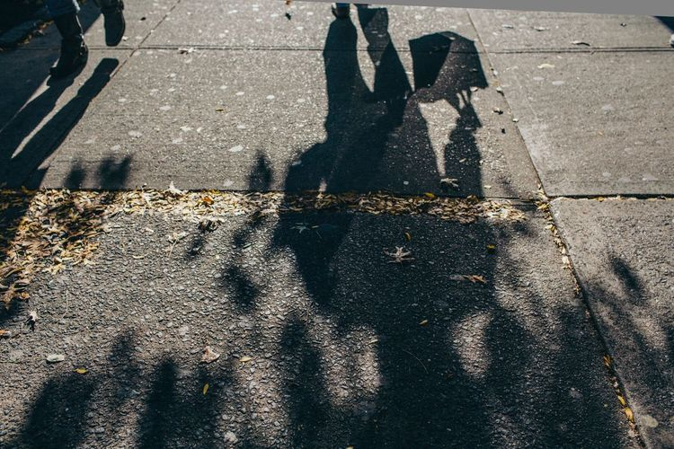 Shadow Focus On Shadow Sunlight Street High Angle View Day Outdoors Asphalt Road Real People Low Section Human Leg Lifestyles People City Adult Only Men