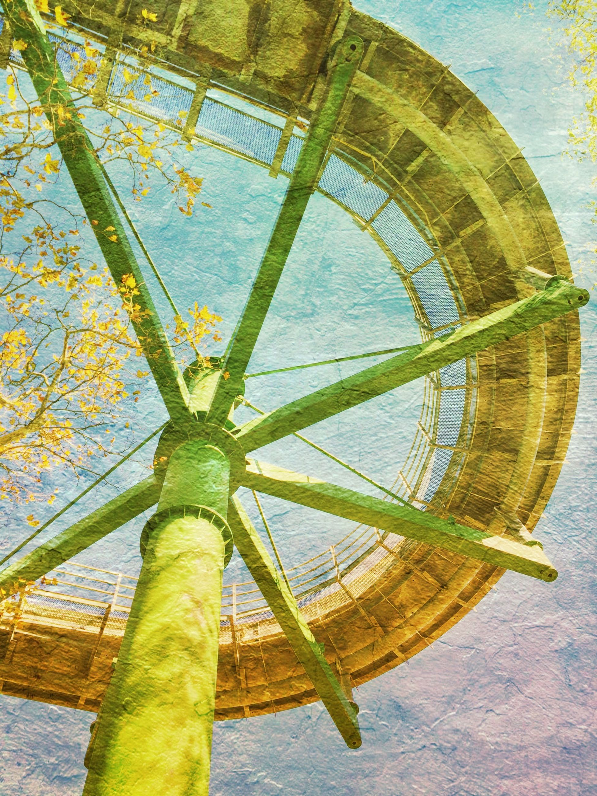 water, built structure, wood - material, day, architecture, nature, circle, no people, blue, outdoors, tree, sunlight, metal, pattern, green color, sky, yellow, tranquility, art, art and craft