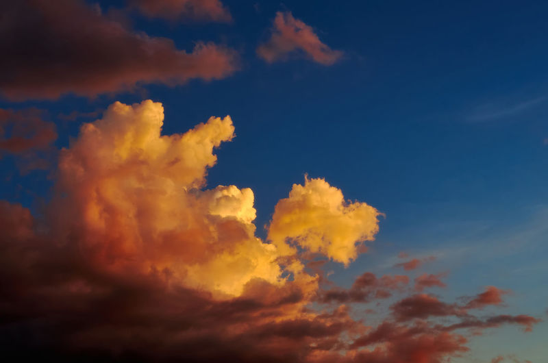 Low angle view of orange cloudy sky