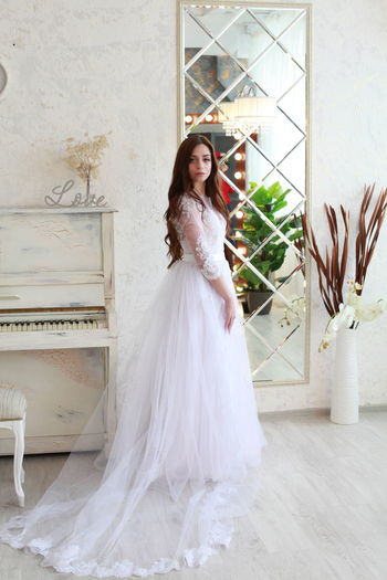 Wedding Newlywed Bride Full Length Wedding Dress Young Adult Event One Person Celebration Real People Adult Looking At Camera Women Lifestyles Fashion Portrait Standing Young Women Life Events White Color Beautiful Woman