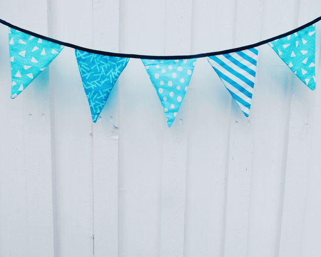 Close-up of bunting against wall