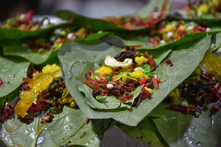 Close-up of fruits and leaves on plate