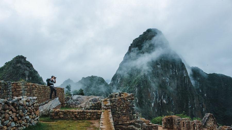 Tourist visiting machu picchu