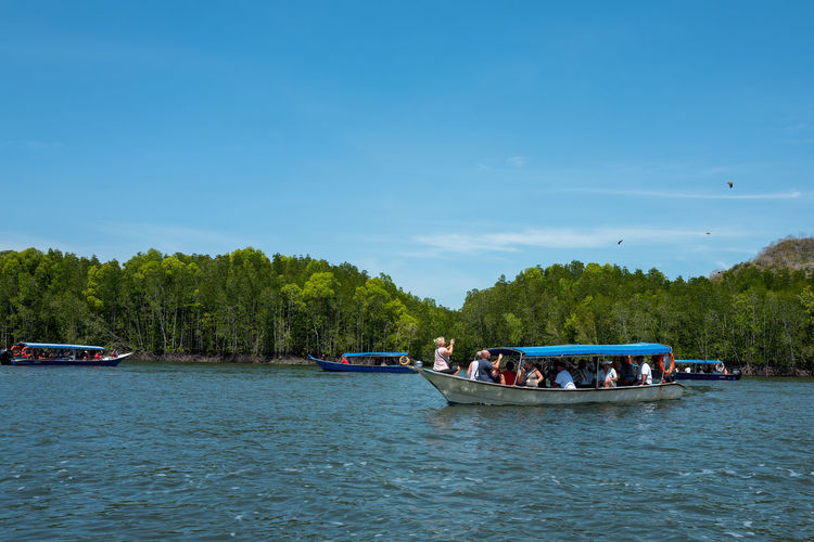 Langkawi Water Nautical Vessel Transportation Waterfront Plant Tree Sky Mode Of Transportation Group Of People Day Real People Travel River Nature Men Beauty In Nature Scenics - Nature Trip Leisure Activity Outdoors