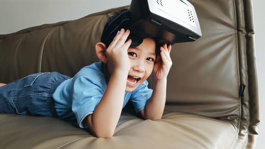 My Favorite Photo Still Life Human Meets Technology Human Kid Boy Virtual Reality Technology Google Cardboard Sofa Casual Clothing Toddler  Play Playing Games Headset The Portraitist - 2016 EyeEm Awards The Mix Up Festival Season
