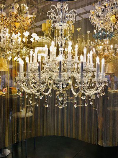 Illuminated chandelier on table in restaurant