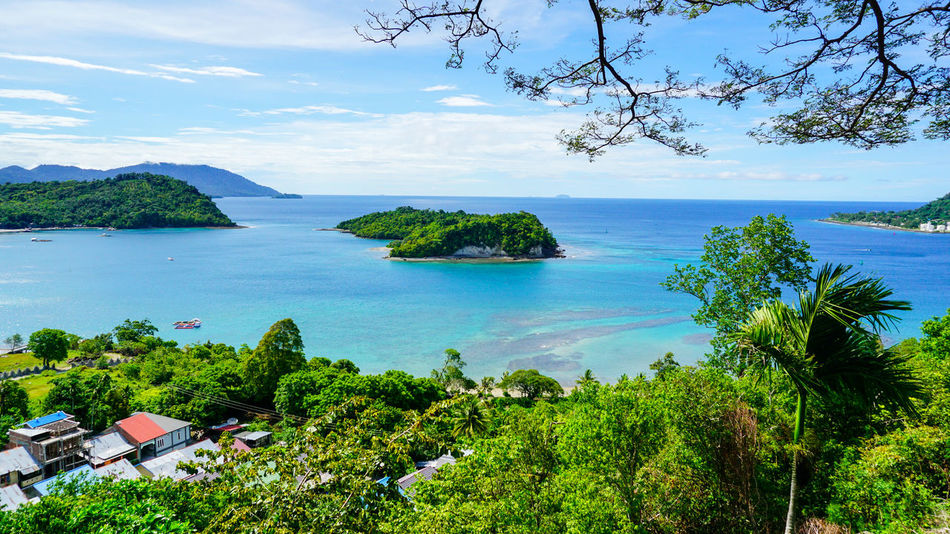 An Island at Sabang Island Indonesia with clear blue water Aceh Aceh, Indonesia INDONESIA Acheh Beach Beauty In Nature Day Growth Horizon Over Water Mountain Nature No People Outdoors Sabah Sabang Island Sabangisland Scenics Sea Sky Tranquil Scene Tranquility Tree Water
