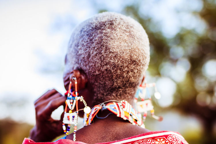 Old and Wise - Maasai Healer Anonymous Africa Bokeh Close-up Day Decoration Focus On Foreground Headshot Healer Leisure Activity Lifestyles Maasai Masai Necklace Old One Person Outdoors People Real People Rear View Short Hair Sky Traditional Tree Wise EyeEmNewHere An Eye For Travel