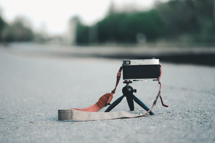 Close-up of camera on road
