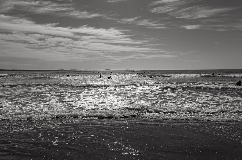 Swimmers on a beach at Port Macquarie, Australia. Sea Horizon Over Water Beach Scenics Nature Sky Beauty In Nature Summer Tranquility Water Outdoors Travel Destinations Port Macquarie The Week On EyeEm New South Wales  Australia Swimming Swimmers Vacations Day Black And White Silhouettes Sun Sunny