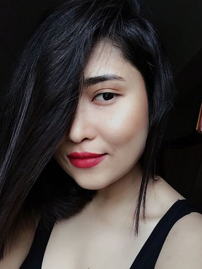 EyeEm Selects Headshot Real People Looking At Camera One Person Portrait Black Hair Beautiful Woman Young Adult Long Hair Lipstick Close-up Young Women Make-up Beauty Human Body Part Human Face Lifestyles Studio Shot Smiling Red Lipstick