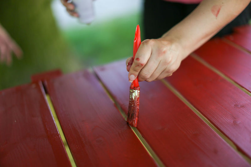 A wooden board is colored in red Close-up Color Color Roller Pensil Pint Red Red Red Color Renovating Renovation Renovations Renovierung Roller Rot Streichen Work