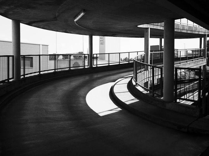 Empty bridge against sky in city