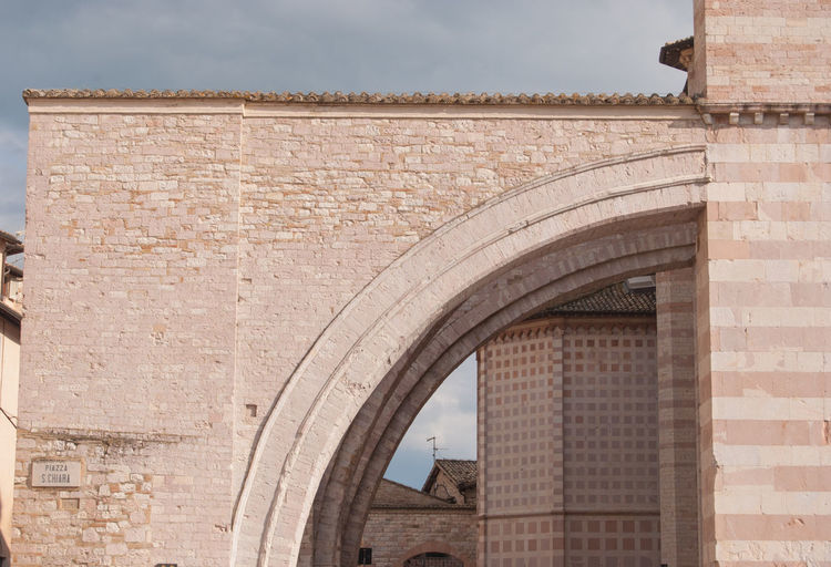 Ancient History Arch Architecture Brick Brick Wall Building Building Exterior Built Structure Church Architecture City History Location Low Angle View Nature No People Outdoors Place Santa Chiara D'Assisi Sky Stone Wall The Past Tourism Travel Travel Destinations Wall