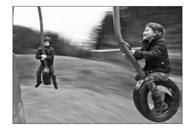 Black And White Childhood Day Dynamic Photo Full Length Fun Girls Joy Leisure Activity Lifestyles Motion On Carrousel One Person Outdoors People Real People Riding Young Adult
