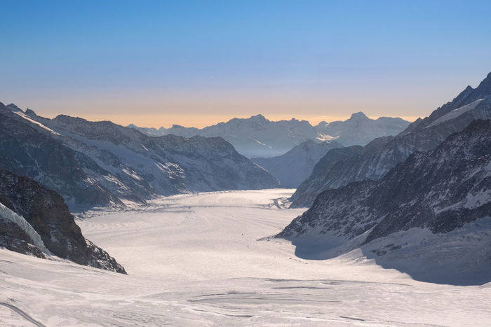 Aletsch Glacier, Jungfrau Switzerland Hiking Winter Clear Sky Cold Temperature Europe Experience Explore Extream Glacier Hike Hikingadventures Mountain Mountain Peak Nature Outdoors Scenics - Nature Sky Snow Summit Sunrise Sunset Swiss Alps Switzerland Top Of Europe Travel Destinations