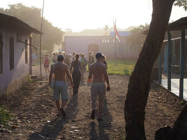 Our Gadventures group walking through the town of Tortuguero at sunset. -------------------------------------------------- Tortuguero  Costarica Costarica2015 Gadventures Gadventurestour Tour Explorecostarica Friends Sunset Sunsets Sunset_madness Sunrise_sunsets_aroundworld Travel Travelling Instatravel Olympus Wanderlust Wanderlustcontest Town
