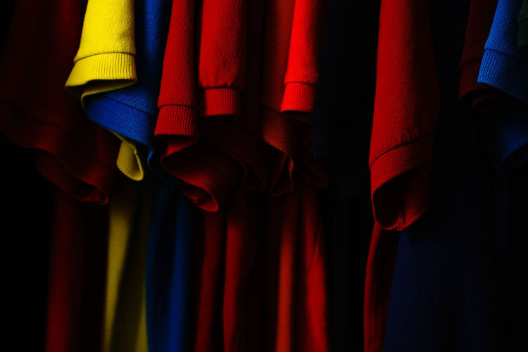 Polo Shirt  Polo Indoors  Curtain Red Textile Close-up Clothing Multi Colored No People Security Hanging Focus On Foreground Arts Culture And Entertainment Stage - Performance Space Stage Performance Variation Choice Closet Fashion Stories Fashion