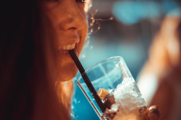 Cropped Image Of Woman Having Drink