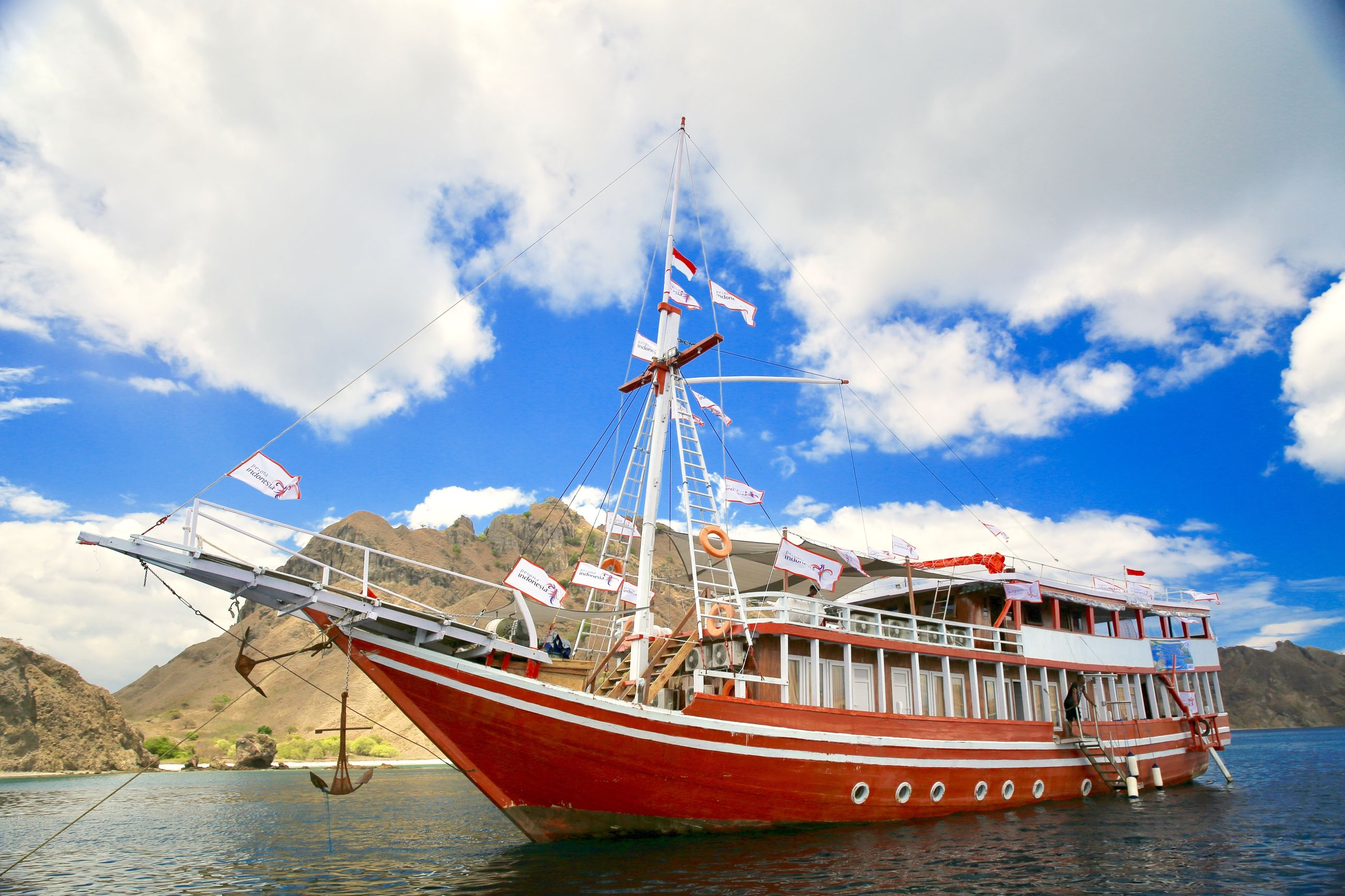 nautical vessel, transportation, cloud - sky, mode of transport, sky, water, boat, day, moored, nature, outdoors, sea, no people, blue, mast, beauty in nature, sailing ship