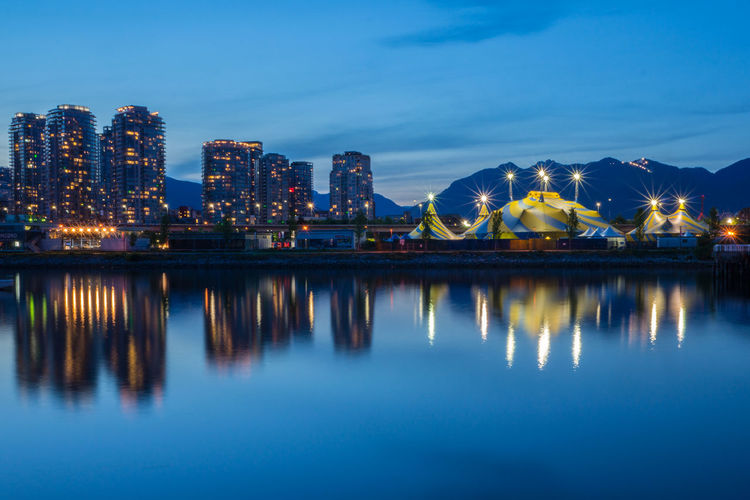 Architecture Building Exterior Built Structure City City Life Cityscape Development Geometry Horizontal Symmetry Outdoors Reflection Residential District Symmetry Water Waterfront